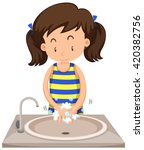 Girl Washing Hands In The Sink...