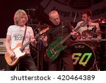 Small photo of WROCLAW, POLAND - MAY 1, 2016: Rick Parfitt and Francis Ross from Status Quo band during concert Guitar Guinness World Record.