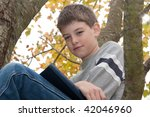 Boy Sitting In A Fall Tree...