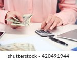 woman counting money and making ... | Shutterstock . vector #420491944