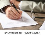 male hand with pen signing... | Shutterstock . vector #420592264
