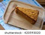 thai tea cake on a wooden plate    Shutterstock . vector #420593020