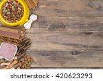 Stock photo dog food selection on wooden background with copy space top view 420623293