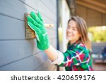 cheerful young woman applying... | Shutterstock . vector #420659176