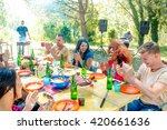 group of friends at garden... | Shutterstock . vector #420661636