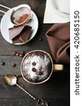 Small photo of Chocolate fondant cake in cup on wooden background