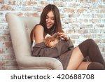 beautiful young woman sitting... | Shutterstock . vector #420688708