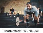 fit young man lifting barbells... | Shutterstock . vector #420708253