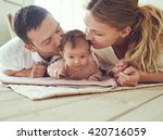 proud mother and father smiling ... | Shutterstock . vector #420716059