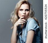portrait of a beautiful blonde... | Shutterstock . vector #420755524