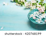Stock photo aroma bowl with water and white blossom flowers on turquoise blue shabby chic wooden background 420768199