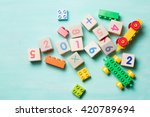 wooden cubes with numbers and...