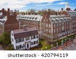 Aerial view on John F Kennedy Street in the Harvard University Area in Cambridge, Massachusetts, the USA. Eliot House white belltower seen on the background.