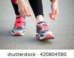 female hands tying shoelace on... | Shutterstock . vector #420804580