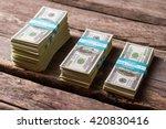 dollar bundles on wooden... | Shutterstock . vector #420830416