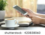 girl hand connecting charger to ... | Shutterstock . vector #420838060