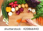young woman cutting vegetables... | Shutterstock . vector #420866443