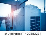 Small photo of Air conditioning system assembled on top of a building.