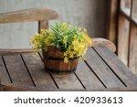 Plastic Flowers In Wooden...