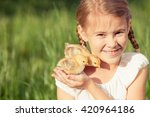Portrait Of Little Girl With...