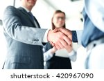 Stock photo business people shaking hands finishing up a meeting 420967090