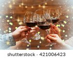 clinking glasses of red wine in ... | Shutterstock . vector #421006423