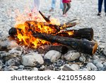 Small photo of Kids enjoying time by the river and self-made campfire during adventurous camping trip, spending quality time together. Active natural lifestyle, family time concept.