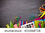 school supplies on blackboard... | Shutterstock . vector #421068718