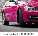 pink car  outdoors
