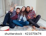 three smiling friends sitting... | Shutterstock . vector #421070674