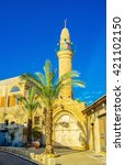 Small photo of The stone minaret and ablution fountain of Mahmoudiya Mosque, that is the largest and most significant mosque in Jaffa, Tel Aviv, Israel.
