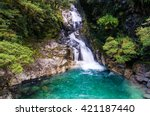 Secluded Waterfall In Tropical...