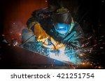 worker welding metal with... | Shutterstock . vector #421251754