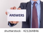 man showing paper with answers... | Shutterstock . vector #421264846