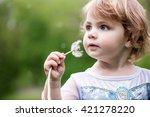 a girl holding a dandelion | Shutterstock . vector #421278220