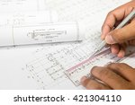 hand holding a pencil  ruler... | Shutterstock . vector #421304110