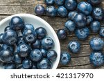 tasty blueberries fruit in bowl.... | Shutterstock . vector #421317970