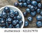 tasty blueberries fruit in bowl.... | Shutterstock . vector #421317970
