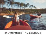 Young Couple Canoeing On The...