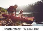 Young Man Pushes A Canoe In Th...