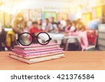 glasses on books with blur...   Shutterstock . vector #421376584