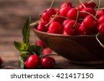 ripe cherries on wooden table... | Shutterstock . vector #421417150