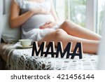 pregnant woman sitting near the ... | Shutterstock . vector #421456144