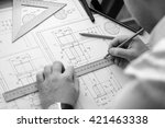 close up of hands of architect... | Shutterstock . vector #421463338