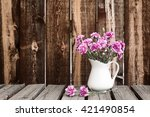 a white pitcher filled  with...   Shutterstock . vector #421490854