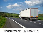 white truck departing on an... | Shutterstock . vector #421552819