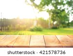wood table top with fence and... | Shutterstock . vector #421578736
