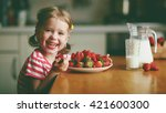 happy child girl drinks milk... | Shutterstock . vector #421600300