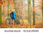 happy active woman riding bike... | Shutterstock . vector #421614040