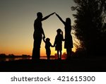 silhouette of a happy family... | Shutterstock . vector #421615300